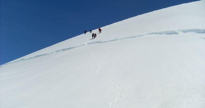 Group of people coming down the Hrútfjallstindar Peaks in the Vatnajokull glacier