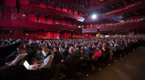 The impressive Eldborg auditorium at the Harpa Concert Hall is filled with EVE Online fans.