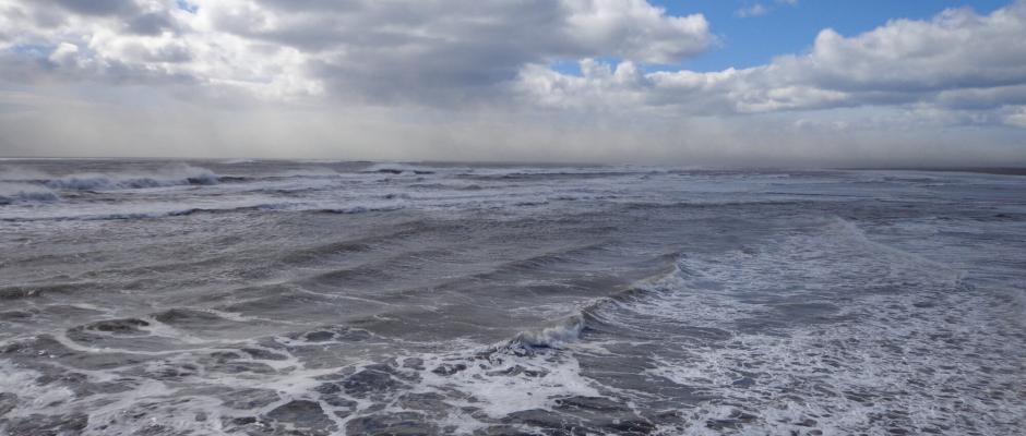 Heavy waves and stormy skies at Landeyjarhöfn harbour