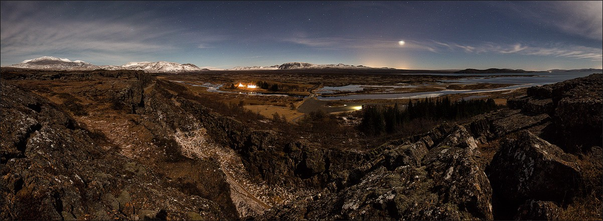 Panorama view of Thingvellir and a full moon.
