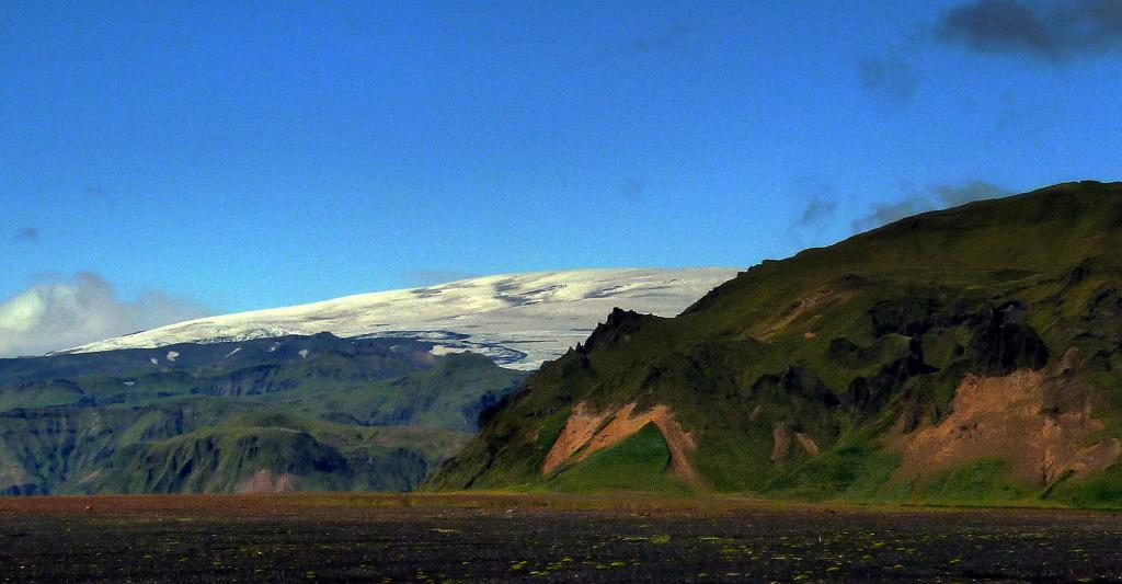 Hafursey mountain. Mýrdalsjökull glacier in the background. The monster volcano Katla sleeps restlessly underneath.