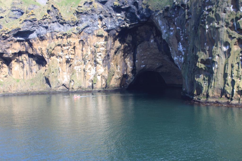 Azure seas and hidden cave in the Vestman islands.
