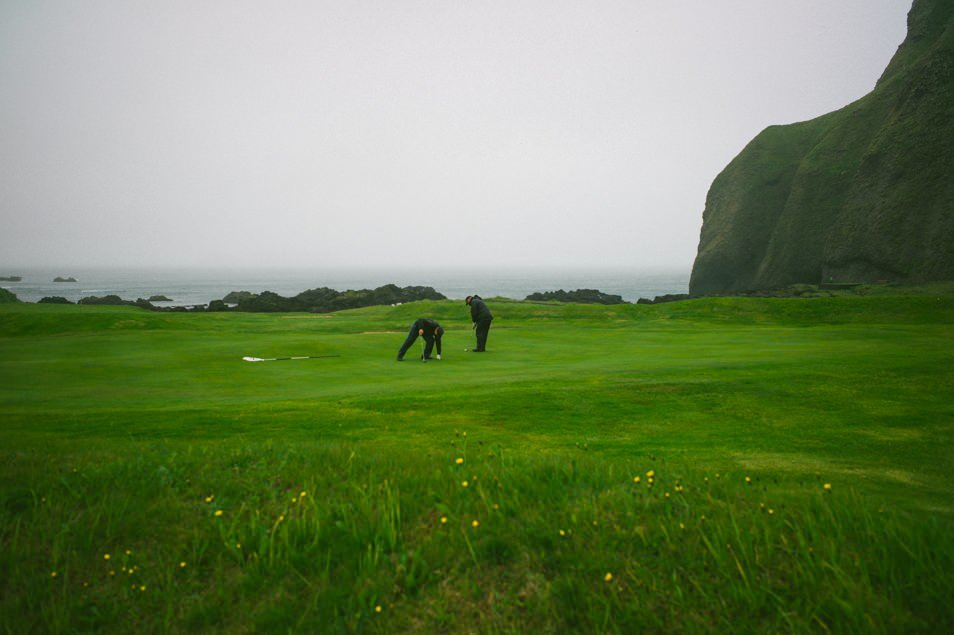 Golfing in the mist.