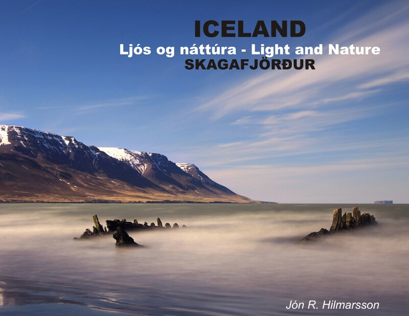 """Front cover of the first book """"Light and Nature of Skagafjordur"""". The shipwreck Ernan at the beach close to the town Sauðárkrókur."""