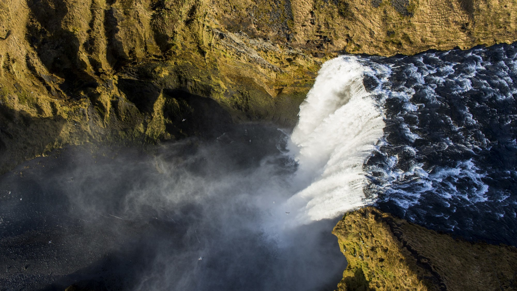 Skogarfoss waterfall seen from a drone.
