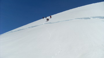 Crossing a crevice in Vatnajokul glacier - coming down from Hrutfjallstindar peaks