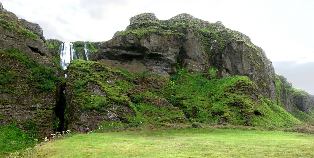 Gljúfrabúi Waterfall hiding right next door to one of Iceland´s most famous waterfalls, Seljalandsfoss.