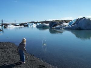 Little girl and and a massive glacial lagoon.
