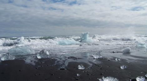 The waves of the North Atlantic hurl icebergs on to the south of the Jökulsárlón beach.