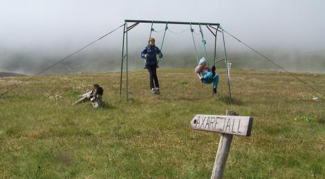 Girls on swings at Hornbjargsviti light house.