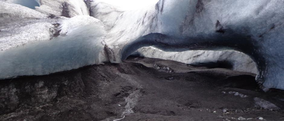 An ice roof at the edge of the glacier. Standing underneath it is dangerous.