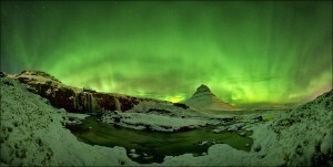 Like fireworks the northern lights light up the sky above Kirkjufell.