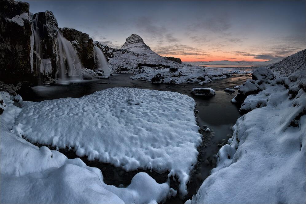 Mount Kirkjufell in winter dusk.