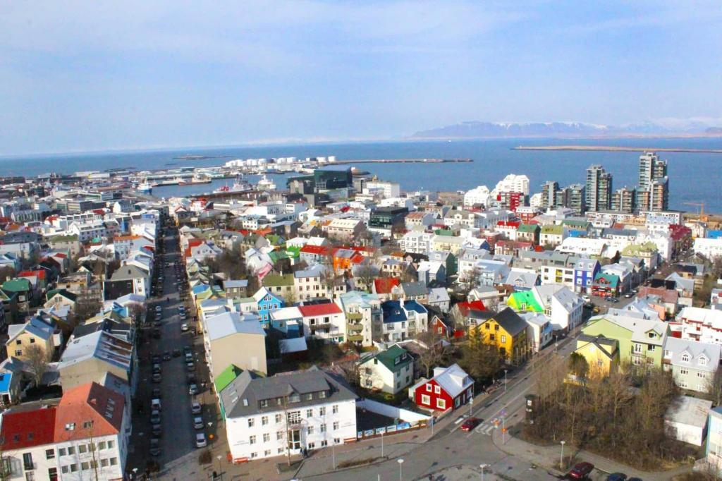 Quiet and peaceful during the day, but sometime in the period between evening and night, the streets come alive, and the nightlife becomes as colourful as the rooftops of Reykjavik's buildings.