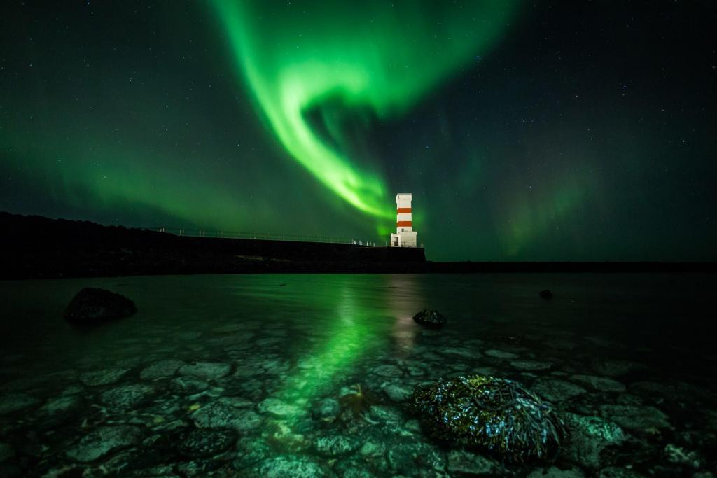 The Northern Lights Above Gardskagaviti Lighthouse.