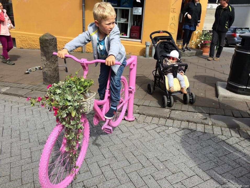 Kid on a bike in Reykjavik, Iceland, not going far!