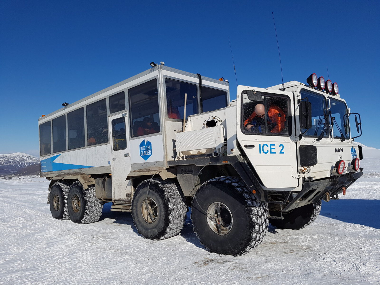Take a ride with this truck to the top of the glacier and then descend right down to its heart.