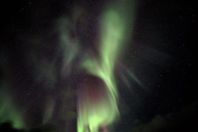 Icelandic northern lights light up the sky.