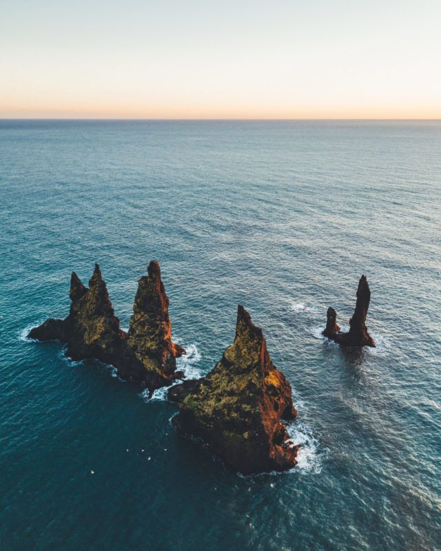 The Reynisdrangar sea stacks by the black beach.