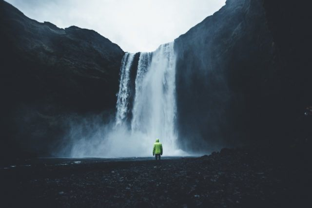Skógafoss waterfall is a popular destination on a road trip in Iceland.