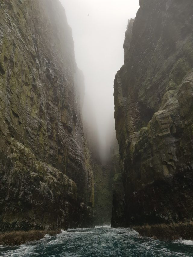 Entering a massive cave in the Faroese sea cliffs.