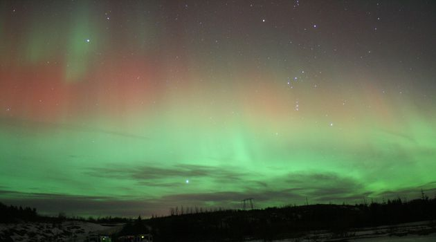 The northern lights shine bright over Iceland.