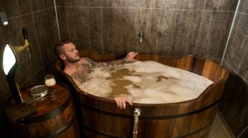 Man soaks in a beer spa in Iceland.