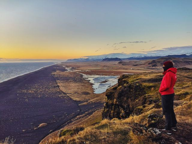 Photographer Mehdi Giaimo by a black beach in Iceland.